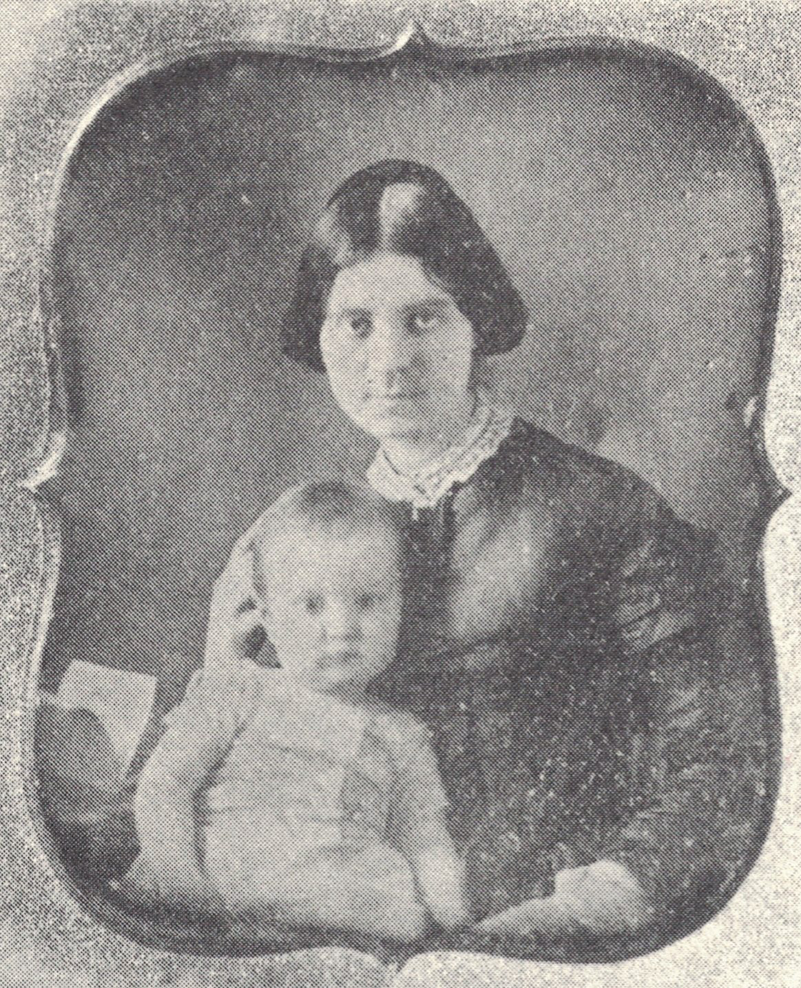 Emily (Baker) Taylor holding Bagby baby
