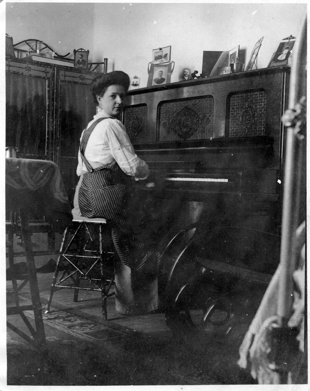 Olive Nicklos at piano